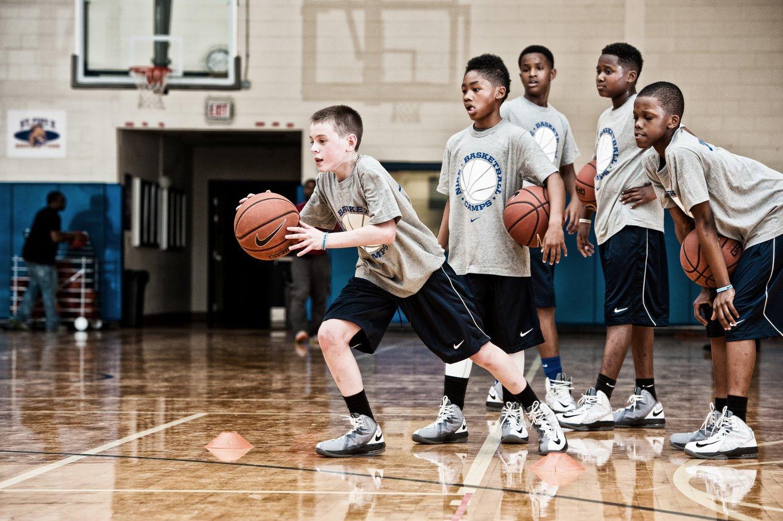 kids learning basketball