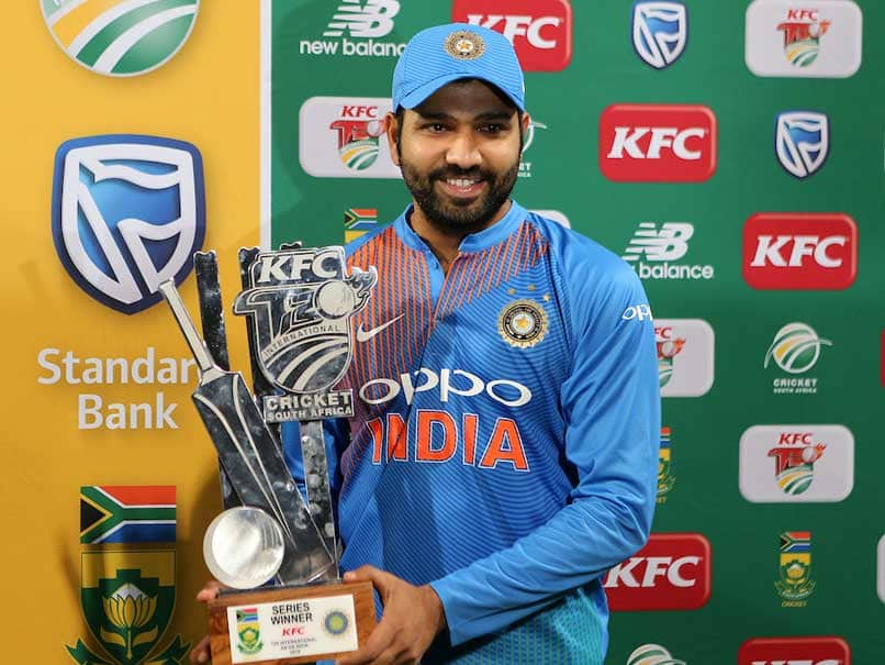 rohit sharma with trophy