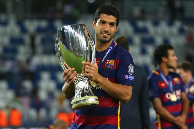 Luis Suarez with trophies