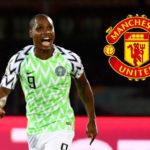 Manchester United's Ole Gunnar Solskjaer gets in Shangai Shehua's striker